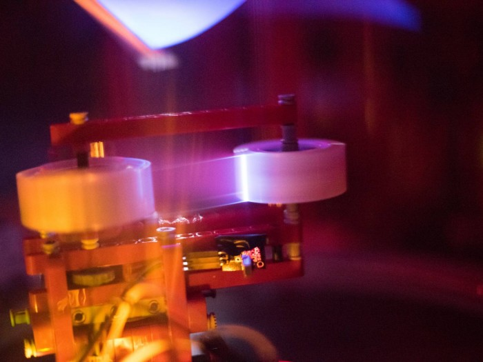 Tape dispenser and phosphor screen setup within the vacuum chamber